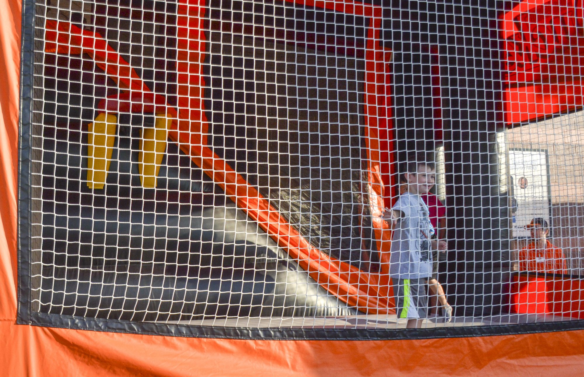 A young Ducks fan plays in the bouncy house at the Long Island Ducks game on Wednesday, July 24, 2019. At Bethpage Ballpark, a new kids zone was created to entertain children. Photo by Olivia Mintz.