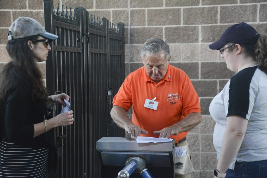 Staff at Bethpage Ballpark always work to make fans feel welcome. Here a ticket taker welcomes fans for the Long Island Ducks vs. New Britain Bees game on Wednesday, July 24, 2019. Photo by Amanda Mitchell.
