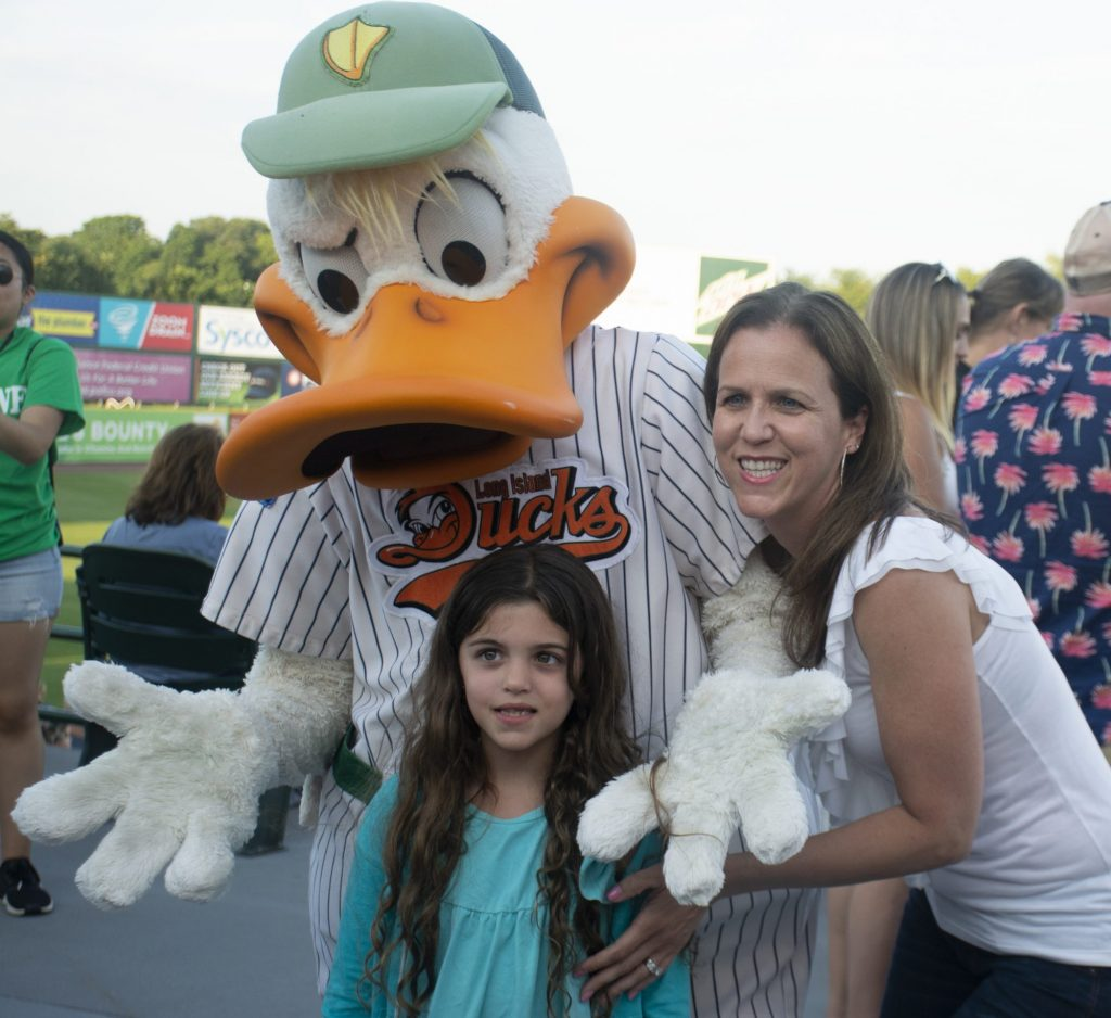 Quackerjack is a fan favorite at Long Island Ducks Games. Here he poses with fans for the Long Island Ducks vs. New Britain Bees game on Wednesday, July 24, 2019. Photo by Amanda Mitchell.