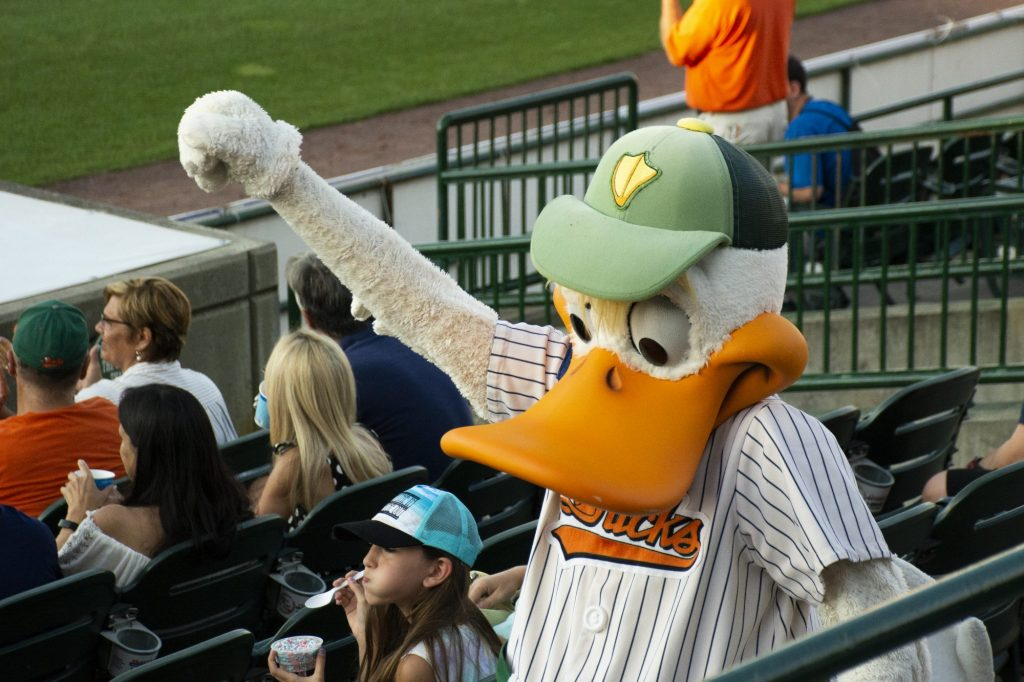 QuackerJack, The Long Island Ducks mascot hypes up the fans at the Bethpage Ballpark as they play against the New Britain Bees at on Wednesday, July 24, 2019 during their 20th anniversary season. Photo by Candace Morgan.